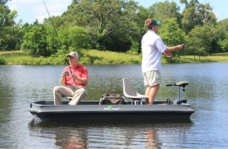 Bass Hunter Bh120 Small Bass Fishing Boat Shown In A Lake With Two Fishermen In The Boat One Standing Up And Fishing Hooked On Wild Waters